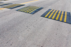 Speed bump. A road speed bump to control motorist speed on a road Stock Photo