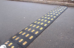 Speed bump. Rubber speed bump on a road Royalty Free Stock Image