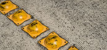 Speed bump on asphalt road closeup - speed bump on street stock photos