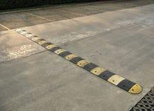 Speed bump on a concrete road Stock Photos