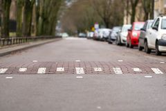 Speed bump on empty street in Warsaw, Poland, cars on one side of the street, challenge symbol royalty free stock photography