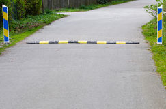 Speed bump. A speed bump on a road stock photography