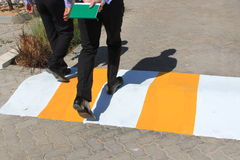 Speed bump on the road with pedestrians Royalty Free Stock Images