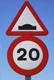 Speed bump sign. Two spanish traffic signs. Limit of velocity and speed bump royalty free stock image