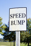 Speed Bump Sign. A white informational speed bump ahead sign in a local park in South Carolina, USA Stock Photos