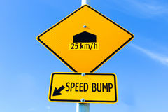 Speed bump sign with speed recommendation Royalty Free Stock Image