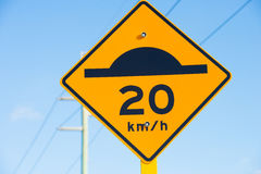Speed bump and slow down warning sign Stock Image
