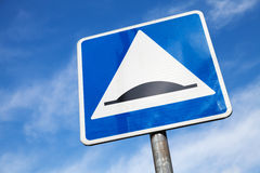 Speed Bump. Square road sign over cloudy sky Royalty Free Stock Images
