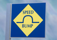 Speed Bump Transportation Sign. Alerting drivers of a speed bump ahead Stock Images