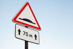 Speed Bump. Warning road sign Stock Image