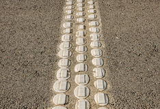 Speed bumps on asphalt road. Royalty Free Stock Photos