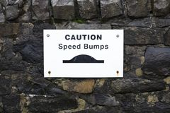 Speed bumps road safety sign. Uk stock photography