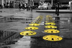 Speed bumps on Wenceslas square. Some yellow speed bumps on the Wenceslas square in Prague after rain royalty free stock photography