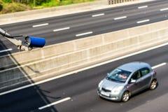 Speed camera monitoring traffic on UK Motorway.  stock image