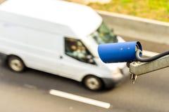 Speed camera monitoring traffic on UK Motorway.  Royalty Free Stock Images
