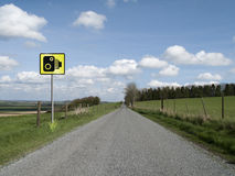 Speed camera. Roadside speed camera on single country lane through countryside and farmland Royalty Free Stock Images