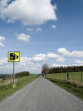 Speed camera. Roadside speed camera on single country lane through countryside and farmland Royalty Free Stock Photo