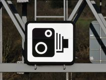 Speed camera sign on gantry above the M25 Motorway in Hertfordshire stock photo