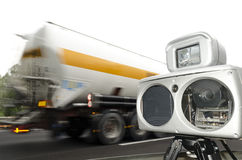 Speed camera and a speed truck Royalty Free Stock Photo