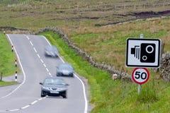 Speed camera with speeding cars Stock Photography