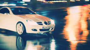 Speed car. Powerfull and fancy carrunning with high speed  in the night Stock Image