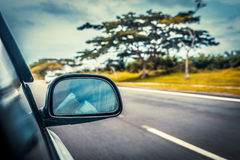 Speed car driving at high speed on empty road Stock Photo