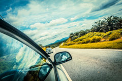 Speed car driving at high speed on empty road Royalty Free Stock Images