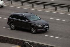 Luxury car black Audi speeding on empty highway royalty free stock photography