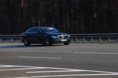 Luxury car black Mercedes Benz speeding on empty highway Royalty Free Stock Photography