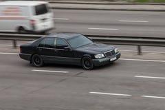 Luxury car black mercedes benz 600 speeding on empty highway royalty free stock photos