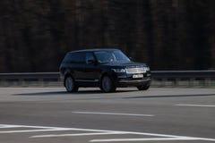 Luxury car Range Rover speeding on empty highway stock photos