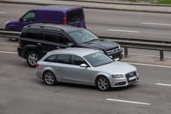 Luxury car silver audi speeding on empty highway Royalty Free Stock Image