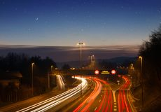Speed concept of moving traffic on highway, motorway at sunset. stock images