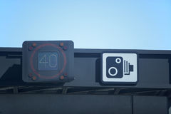 Speed Detector Next To Speed Camera Warning Sign Royalty Free Stock Photos