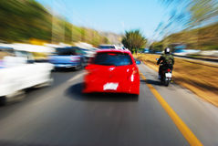 Speed drive following red car. On the road stock image