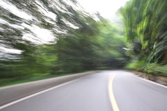 Speed drive on mountain road Stock Image