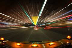 Speed Driving in Los Angeles With Bright City Ligh. Driving the Streets of Los Angeles at Night With Lights Around Royalty Free Stock Photo