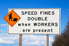 Speed fines double sign along highway Stock Photos