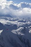 Speed flying in snow mountains Royalty Free Stock Image