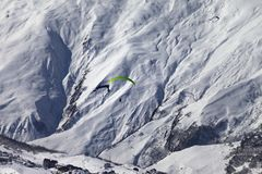 Speed flying in snow mountains in sunny nice day Royalty Free Stock Images