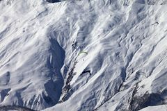 Speed flying in winter mountains in sun nice day Stock Photography