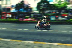 Speed girl. Ride the motorcycle Royalty Free Stock Photography