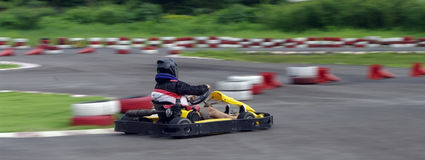 Speed go-cart racing. Go-cart racer ride fast competition Royalty Free Stock Images