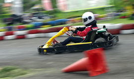Speed go-cart racing. Go-cart racer ride fast competition Stock Photos
