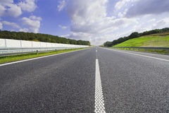 Speed highway. Empty highway with a sky summer Royalty Free Stock Image