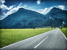 Speed highway near mountains Royalty Free Stock Photography