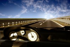Speed-indicator. Car, speed indicator, way and sky Stock Photos