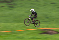 Speed jump motion biker Stock Photos