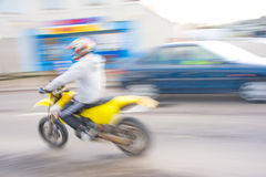 Speed kills. A blurred image of a motorbike giving a distinct impression of excessive speed and suggesting ' speed kills Royalty Free Stock Photography