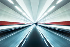 Speed Tunnel. Horizontal photo of speed tunnel effect. This is a scene from a metro station. Lights and walls are blurred with motion effect Royalty Free Stock Photos